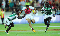 England's Marcus Watson splits the Kenyan defence in the final at the IRB International Rugby Sevens, Westpac, Wellington, New Zealand, Saturday, February 02, 2013. Credit:SNPA / Ross Setford