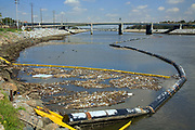 The Garbage boom on the Los Angeles River in Long Beach was built in 2001. Urban runoff carries an assortment of trash and debris from catch basins where a network of pipes and open channels create a pathway to the Ocean. After the first major storm of the season, the boom may collect over 50,000 pounds of trash.