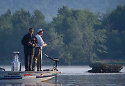 Colorado Avalanche coach Bob Hartley (L) and his friend Guy Laroque went out fishing on the Ottawa River with the Stanley Cup in Hawkesbury, Ontario, July 31, 2001. It is a tradition for each member of the Stanley Cup champion team to take the cup for some personal enjoyment. REUTERS/Jim Young