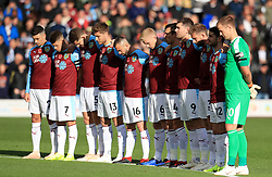Burnley players observe a minute's silence to mark Armistice Day during the Premier League match at Turf Moor, Burnley.
