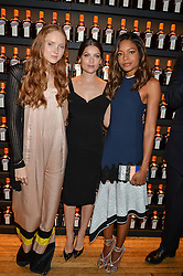 Left to right, LILY COLE, LAETITIA CASTA and NAOMIE HARRIS at the Cointreau Creative Crew Award at Liberty, Great Marlborough Street, London on 24th May 2016.
