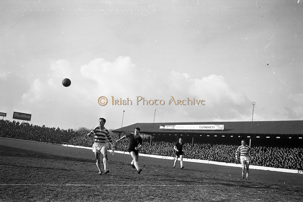 17/02/1963<br /> 02/17/1963<br /> 17 February 1963<br /> Soccer: Shamrock Rovers v Cork Celtic at Glenmalure Park, Milltown.  Cork Celtic forward Sinnott (right) and Shamrock Rovers defender Keogh race for a high ball near Rovers goal.