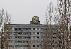 December 22, 2016 - Kiev, Ukraine - The coat of arms of the Soviet Union on the roof of a building in the deserted town of Pripyat,two kilometers from the Chernobyl nuclear power plant, Ukraine, on 22 December,2016. The explosion of Unit four of the Chernobyl nuclear power plant on 26 April 1986 is still regarded the biggest accident of nuclear power generation  in the history. (Credit Image: © Serg Glovny via ZUMA Wire)
