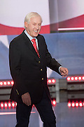 Former National Football League quarterback Fran Tarkenton walks on stage to address delegates on the final day of the Republican National Convention July 21, 2016 in Cleveland, Ohio.