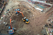 Excavators removing earth from a building site outside Coventry train station on the 28th of April 2021, Coventry, United Kingdom. The train station in Coventry is currently being redeveloped as part of an £82 million project for the Coventry UK City of Culture 2021.