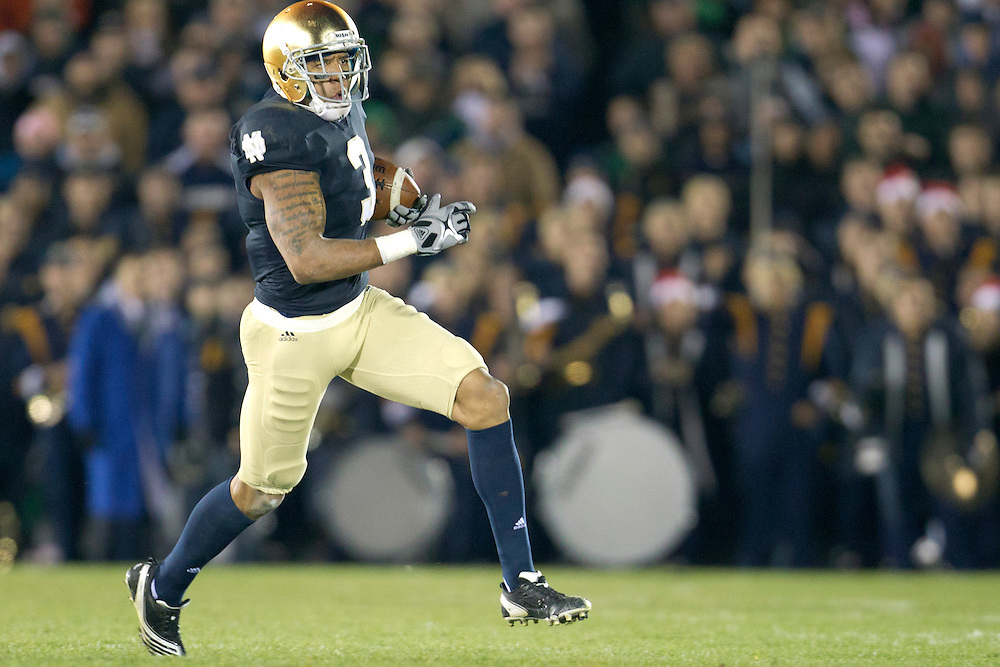 Notre Dame wide receiver Michael Floyd (#3) runs for yardage after the catch during fourth quarter of NCAA football game between Notre Dame and Boston College.  The Notre Dame Fighting Irish defeated the Boston College Eagles 16-14 in game at Notre Dame Stadium in South Bend, Indiana.
