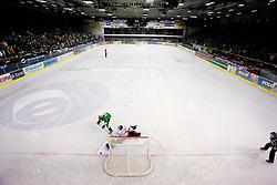 Ziga Pance of Tilia Olimpija vs Goalkeeper of Jesenice Dov Grumet-Morris at 38th Round of EBEL league  ice hockey match between HDD Tilia Olimpija Ljubljana and HK Acroni Jesenice, on January 1, 2010, in Arena Tivoli, Ljubljana, Slovenia. (Photo by Vid Ponikvar / Sportida)