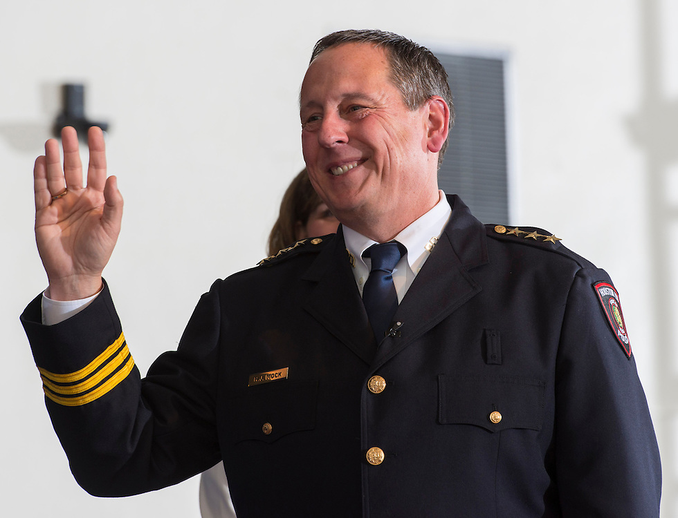 Houston ISD Chief of Police Robert Mock smiles after taking the oath of office during his swearing-in ceremony, January 6, 2014, at the High School for Law Enforcement and Criminal Justice.
