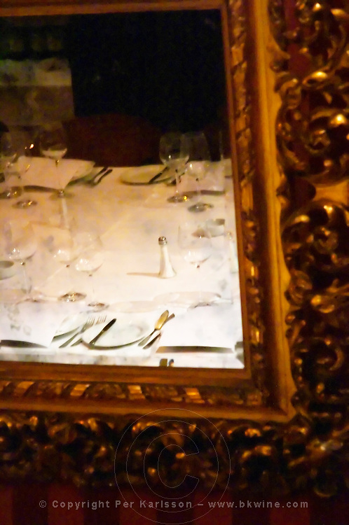 Mirror reflection of the dining table set for guests, mirror in heavy ornamented gild frame The Oviedo Restaurant, Buenos Aires Argentina, South America