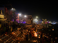 Varanasi, INDIA - CIRCA NOVEMBER 2018: People at night walking on the ghats of Varanasi during the Dev Deepawali celebrations. Varanasi is the spiritual capital of India, the holiest of the seven sacred cities and with that many rituals and offerings are performed daily by priests and hindus.