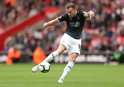 Burnley's Ashley Barnes shoots during the game