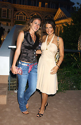 Left to right, FRANCESCA VERSACE and DANIELLA HELAYEL at a summer party hosted by champagne house Krug held at Debbenham House, 8 Addison Road, London on 28th June 2005.<br />