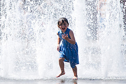 © Licensed to London News Pictures. 06/06/2016. Bradford UK. Children cool of in the water fountains at Bradford City park today in the soaring temperatures. Photo credit: Andrew McCaren/LNP