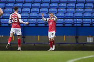 GOAL 0-1 Cheltenham Town forward Alfie May (10) celebrates his goal with team-mates during the EFL Sky Bet League 2 match between Bolton Wanderers and Cheltenham Town at the University of  Bolton Stadium, Bolton, England on 16 January 2021.