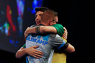 Ron Meulenkamp celebrates his match win and embraces Diogo Portela during the Darts World Championship 2018 at Alexandra Palace, London, United Kingdom on 18 December 2018.