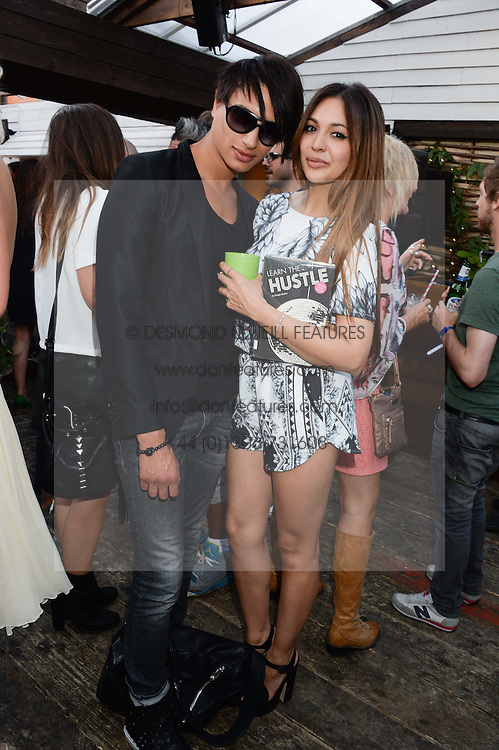 NAT WELLER and ZARA MARTIN attending the Warner Bros. & Esquire Summer Party held at Shoreditch House, Ebor Street, London E1 on 18th July 2013.