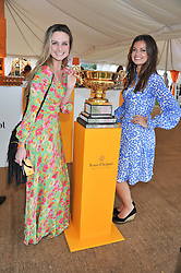 Left toright, BRYONY DANIELS and LADY NATASHA RUFUS-ISAACS at the 2012 Veuve Clicquot Gold Cup Final at Cowdray Park, Midhurst, West Sussex on 15th July 2012.