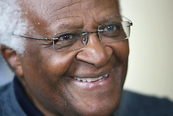 The Nobel Peace prize winner Archbishop Desmond Tutu smiles after meeting members of the Human Rights Consortium and signing a petition for a Bill of Rights for Northern Ireland, at the Hilton hotel in Belfast.