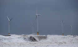 © Licensed to London News Pictures. <br /> 01/02/2015. <br /> <br /> South Gare, Redcar, United Kingdom<br /> <br /> Huge waves crash amongst the offshore wind farm at South Gare near Redcar in Teesside.<br /> <br /> Photo credit : Ian Forsyth/LNP