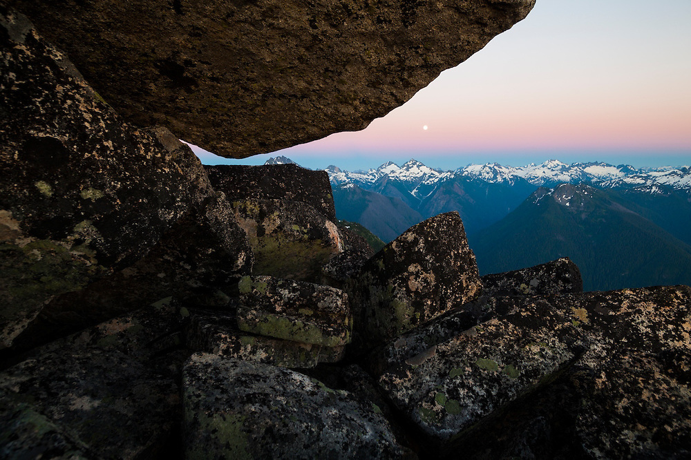Moonrise at dusk over Spider Mountain and Mount Formidable, seen from Hidden Lake Peaks, North Cascades National Park, Washington.