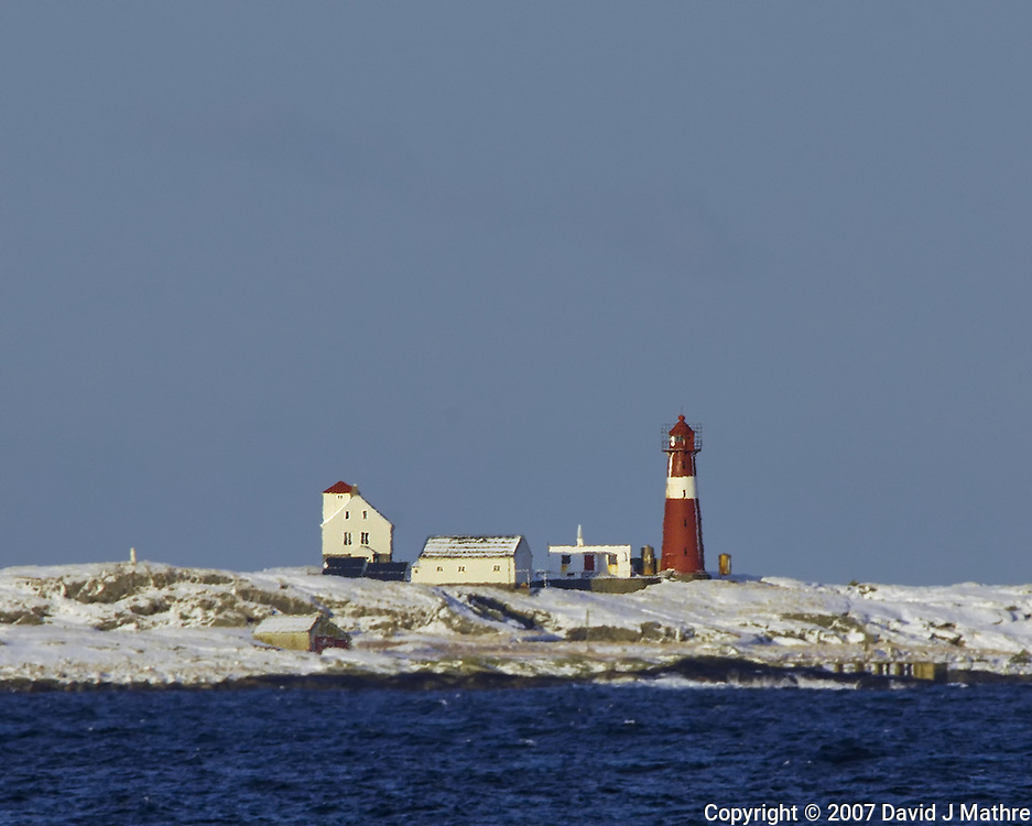 Lighthouse from the Deck of the Hurtigruten MV Kong Harald while Traveling to from Bergen to Alesund. Image taken with a Nikon D2xs and 80-400 mm VR lens (ISO 200, 400 mm, f/9.5, 1/350 sec).