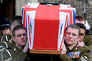 Captain Sawyer's comrades carry his coffin draped in the Union Flag for a private burial