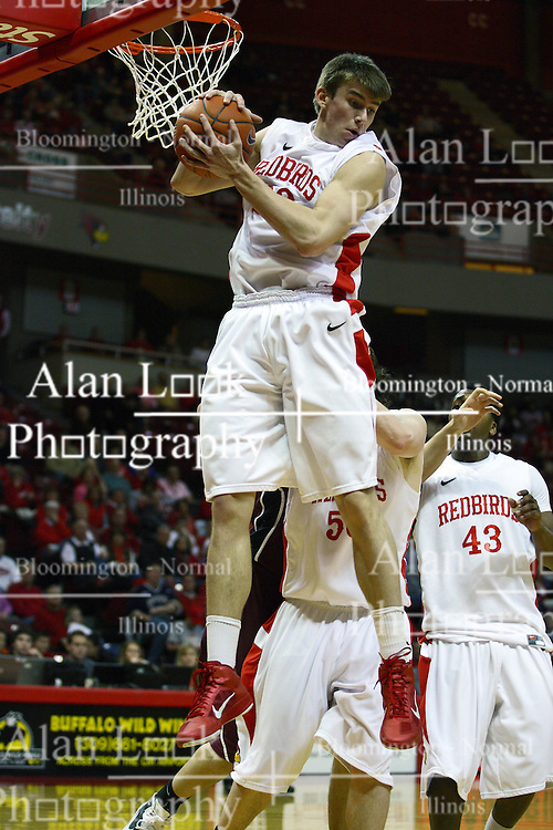 12 February 2011: Jon Ekey gets some air and collects a defensive rebound during an NCAA Missouri Valley Conference basketball game between the Missouri State Bears and the Illinois State Redbirds at Redbird Arena in Normal Illinois.