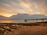 UK Victorian Pier at Clevedon on the Southwest Coast of England sunset after a stormy evening.  Licensing and Open Edition Prints.