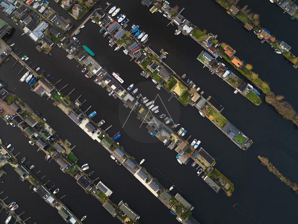 Aerial view of recreational harbour for small boats and bungalows on the lake at Loosdrecht Kalverstraat, the Netherlands.