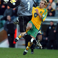 Picture: Henry Browne.<br />Date: 07/02/2004.<br />Wimbledon v Norwich City.<br /><br />Darren Huckerby of Norwich has his attempted lob handled outside the area by keeper Steve Banks who gets sent off.
