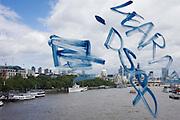 City of London seen through blue graffiti on a bus while crossing Waterloo Bridge.