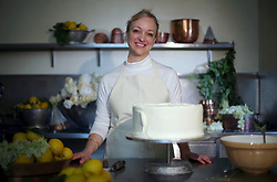 File photo dated 17/05/18 of Claire Ptak, owner of Violet Bakery in Hackney, east London, with a tier of the cake for the wedding of the Duke and Duchess of Sussex, who are preparing for the christening of their son Archie, which will take place on Saturday.