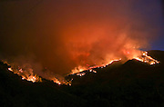 A wildfire burns in the hills near Placenta Canyon Road in Santa Clarita, Calif., Sunday, July 24, 2016.(AP Photo/Ringo H.W. Chiu)
