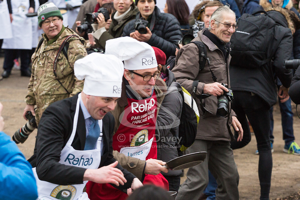 MPs and members of the House of Lords compete in the annual Rehab pancake race, a relay of eleven laps in Victoria Tower Gardens adjacent to the Houses of Parliament in London. The race is held every year on Shrove Tuesday and was won by the Media team. PICTURED: James Landale leads into the first corner. London, February 13 2018.