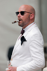 May 3, 2019 - Louisville, KY, U.S. - LOUISVILLE, KY - MAY 03: A race fan enjoys a smoke and a drink on Kentucky Oaks day at Churchill Downs Racetrack on May 4, 2018 in Louisville, Kentucky. (Photo by Jeffrey Brown/Icon Sportswire) (Credit Image: © Jeffrey Brown/Icon SMI via ZUMA Press)