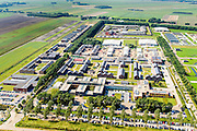 Nederland, Drenthe, Ter Apel, 08-09-2016; overzicht Asielzoekerscentrum AZC Ter Apel, met in het midden nieuwbouw / uitbreiding. Penitiaire Inrichting (PI) Ter Apel in de achtergrond.   <br /> Overview Asielzoekerscentrum AZC Ter Apel <br /> luchtfoto (toeslag op standard tarieven);<br /> aerial photo (additional fee required);<br /> copyright foto/photo Siebe Swart