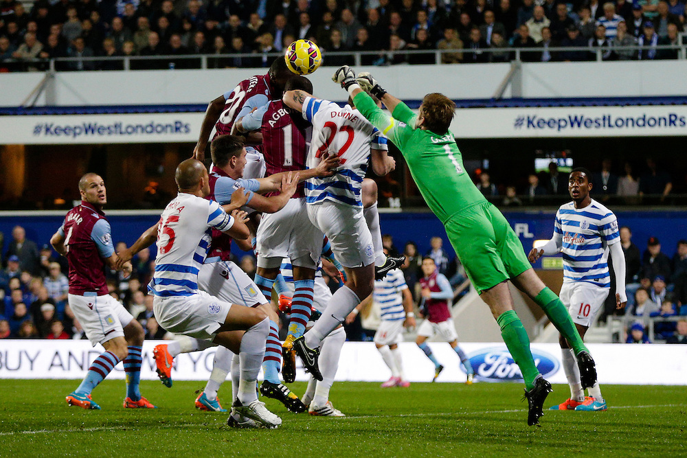 Queens Park Rangers' Robert Green comes out to punch the ball clear<br /> <br /> Photographer Craig Mercer/CameraSport<br /> <br /> Football - Barclays Premiership - Queens Park Rangers v Aston Villa - Monday 27th October 2014 - Loftus Road - London<br /> <br /> © CameraSport - 43 Linden Ave. Countesthorpe. Leicester. England. LE8 5PG - Tel: +44 (0) 116 277 4147 - admin@camerasport.com - www.camerasport.com