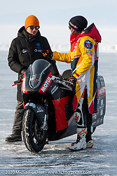 Checking out the Moscow Polytechnic University electric motorcycle racer that was built for the Baikal Mile Ice Speed Festival. Maksimiha, Siberia, Russia. Saturday, February 29, 2020. Photography ©2020 Michael Lichter.