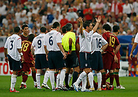 Photo: Glyn Thomas.<br />England v Portugal. Quarter Finals, FIFA World Cup 2006. 01/07/2006.<br /> England's players react angrily as Wayne Rooney (third from L) is sent off.