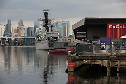 HMS Argyll, the longest-serving Type 23 Frigate in the Royal Navy, is pictured moored alongside ExCeL London against a backdrop of Canary Wharf in advance of the DSEI 2021 arms fair on 12th September 2021 in London, United Kingdom. Activists from a range of different groups continue to protest outside the venue for one of the world's largest arms fairs.