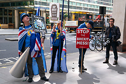 © Licensed to London News Pictures. 30/04/2019. London, UK. Anti-Brexit demonstrators including Steve Bray (left) outside Labour Party headquarters for a National Executive Meeting at which Labour's position on a second EU vote will be decided. Photo credit : Tom Nicholson/LNP