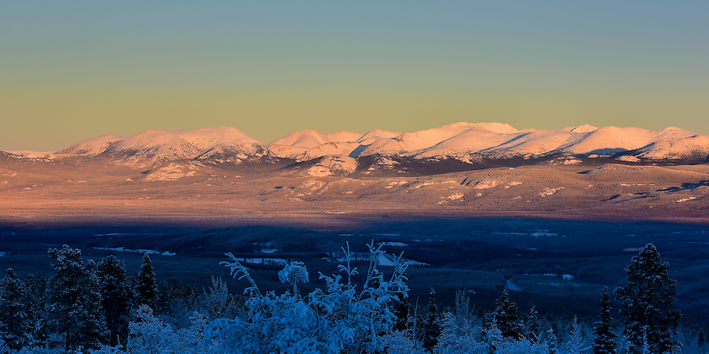 A late-December sunset paints the mountains with beautiful light
