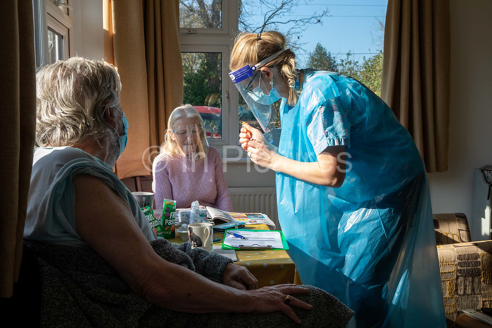 Dr Fordham of the Channel Health Alliance prepares a syringe of the AstraZeneca COVID-19 vaccination before administering it to a housebound patient at their home in the community outside Dover on the 27th of February 2021, Dover, Kent, United Kingdom.