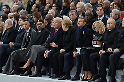 Trump talking with Merkel.<br /> Morocco's King Mohammed VI and his son, first lady Melania Trump, U.S. President Donald Trump, German Chancellor Angela Merkel, Emmanuel Macron and Brigitte Macron, Russian President Vladimir Putin and Australian Governor-General Peter Cosgrove.French President Emmanuel Macron and Brigitte Macron, German Chancellor Angela Merkel, U.S. President Donald Trump, first lady Melania Trump, Morocco's King Mohammed VI, Russian President Vladimir Putin, Australian Governor-General Peter Cosgrove attend a commemoration ceremony for Armistice Day, 100 years after the end of the First World War at the Arc de Triomphe.<br /> Paris,FRANCE-11/11/2018 Photo by Jacques Witt/pool/ABACAPRESS.COM