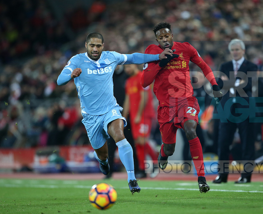 Liverpool's Divock Origi tussles with Stoke's Glen Johnson during the Premier League match at Anfield Stadium, Liverpool. Picture date December 27th, 2016 Pic David Klein/Sportimage