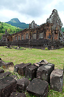 """Vat Phou or Wat Phu, which means """"temple mountain"""" in Lao, is a ruined Khmer temple complex in southern Laos. It is located at the base of mount Phu Kao, some 6km from the Mekong river in Champasak province. There was a temple on the site as early as the 5th century, but the surviving structures that can be seen today date from the 11th to 13th centuries. The temple has a unique structure, in which the elements lead to a shrine where a linga was bathed in water from a mountain spring. The site later became a center of Theravada Buddhist worship which it remains today."""