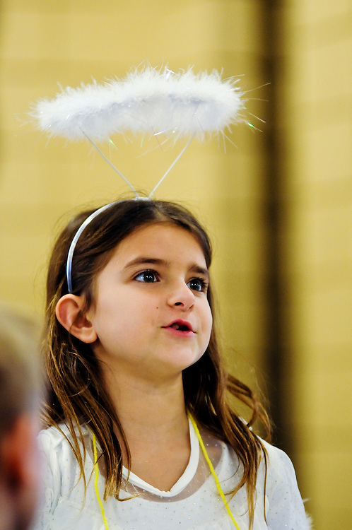 """Second grader Sophia Nakos, 8 portrays St. Gabriel during the the annual Parade of Saints at St. Michael School in Orland Park, February 2. During the event, costumed students stand motionless in the school commons for parents, grandparents and friends to """"activate"""" the Saint, who will offer a brief historical description. The session is followed by a parade through the school. l Brian J. Morowczynski~ViaPhotos..For use in a single edition of Catholic New World Publications, Archdiocese of Chicago. Further use and/or distribution may be negotiated separately. ..Contact ViaPhotos at 708-602-0449 or email brian@viaphotos.com."""