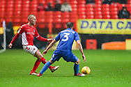 Charlton Athletic midfielder Chris Solly (20) and AFC Wimbledon defender Ben Purrington (3) during the EFL Sky Bet League 1 match between Charlton Athletic and AFC Wimbledon at The Valley, London, England on 15 December 2018.