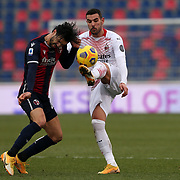 Roberto Soriano (Bologna) heads the ball before Theo Hernandez's kicks during the Serie A Tim match between Bologna FC 1909 and AC Milan at Stadio Renato Dall'Ara on January, 30 2021 in Bologna, Italy.
