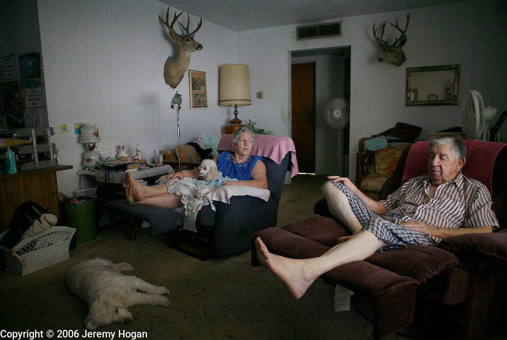 A retired couple in their 80s relaxes at home in Porterville, California.